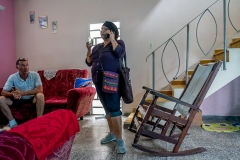 Alicita on the phone, Rigo listening