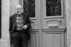Man In Paris Doorway